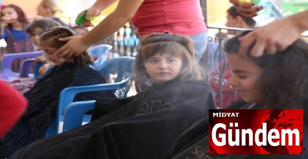 Kumlu Mahallesi'nde 700 Çocuğun Saç bakımı ve kesimi yapıldı
